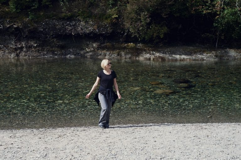 Portrait image of a young woman walking back from a river at Golden Ears Provincial Park