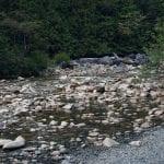 Landscape image of boulders in a river