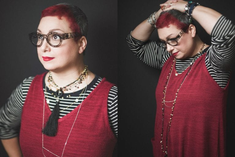 Studio head shot of Salomé from Burfurtart with stacked necklaces, intricate eye glasses, red lips and red hair by Vancouver business portrait and branding photographer Angela McConnell