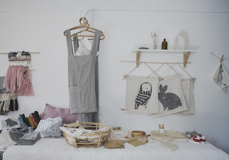 Products hanging on a wall handcrafted by a local maker by Vancouver business portrait and branding photographer Angela McConnell