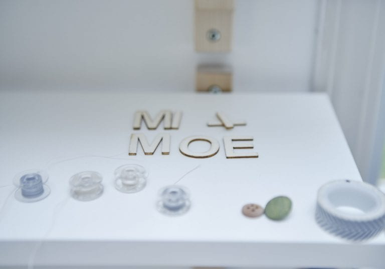 Mi + Moe spelled out on a shelf using small wooden letters by Vancouver business portrait and branding photographer Angela McConnell