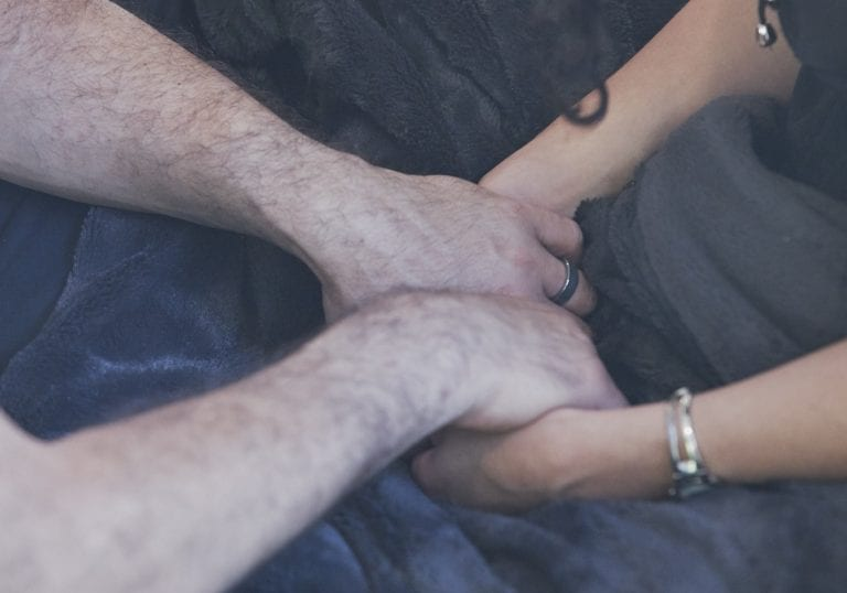A couple hold hands during a Wildfire Retreats date night in Vancouver by workshop and retreat photographer Angela McConnell
