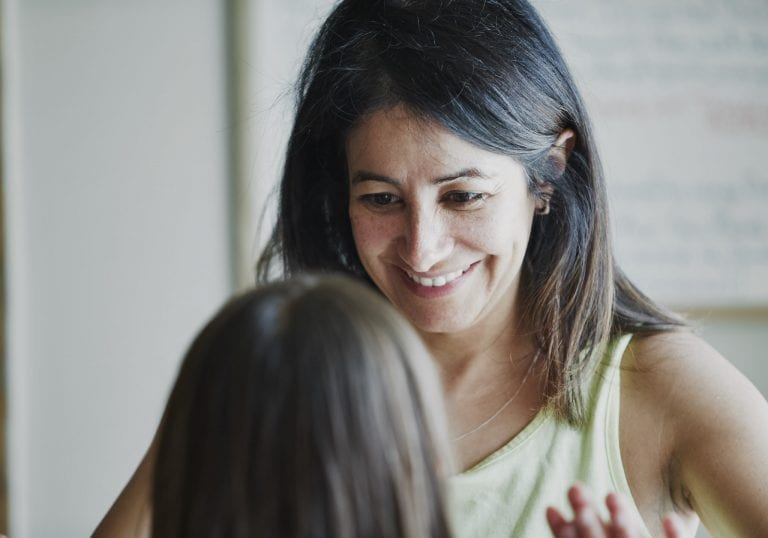 A mother listens and smiles as her daughter is speaking during an exercise at a mother and daughter workshop by Vancouver workshop and retreat photographer Angela McConnell