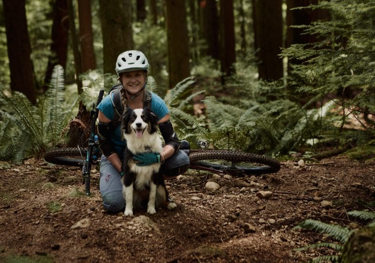 Coaching client mountain biking with Australian shepherd Mt Fromme by Vancouver business portrait and branding photographer Angela McConnell