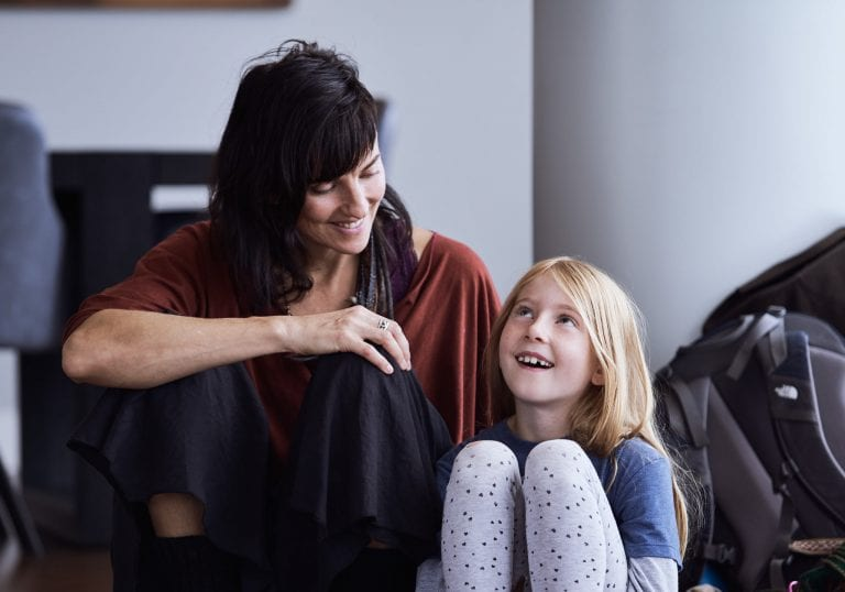 A mother and daughter sit together during an exercise at a mother and daughter workshop by Vancouver workshop and retreat photographer Angela McConnell