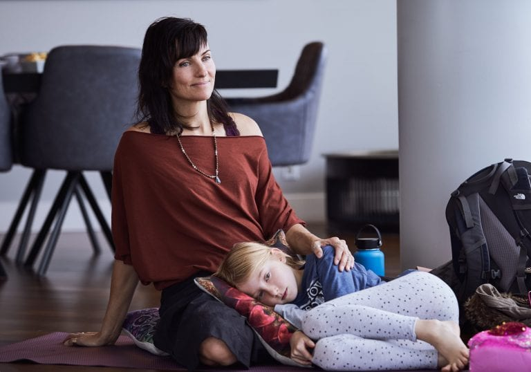 A mother and daughter cuddle during an exercise at a mother and daughter workshop by Vancouver workshop and retreat photographer Angela McConnell