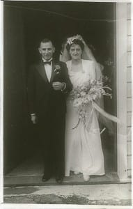 Black and white wedding portrait of a couple in the doorway of a church in 1946. Why Telling your story through Portraits is an important record of our history by Vancouver contemporary portrait photographer Angela McConnell