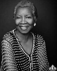Image of an older woman smiling at the camera during a portrait session by Vancouver contemporary portrait photographer Angela McConnell
