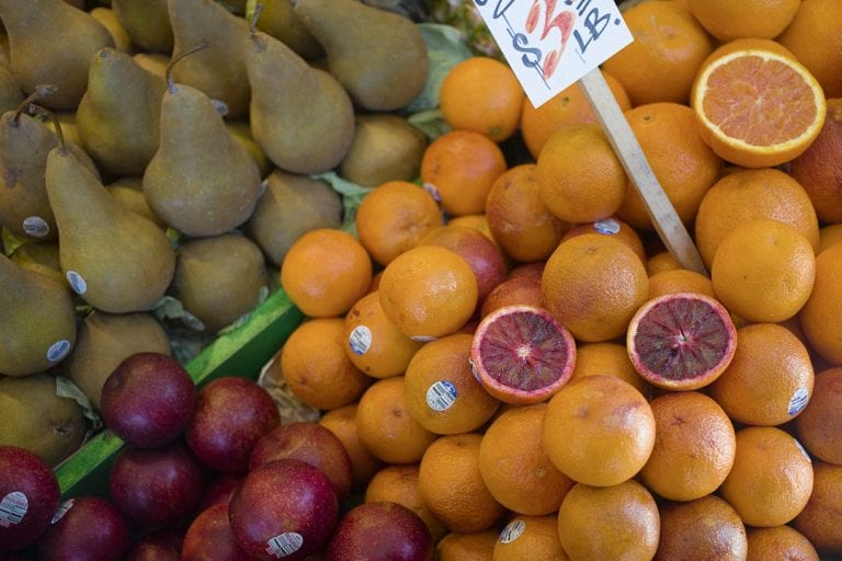 Blood oranges, pears and plums on display for sale at a fruit shop in Pike Place Market in Seattle