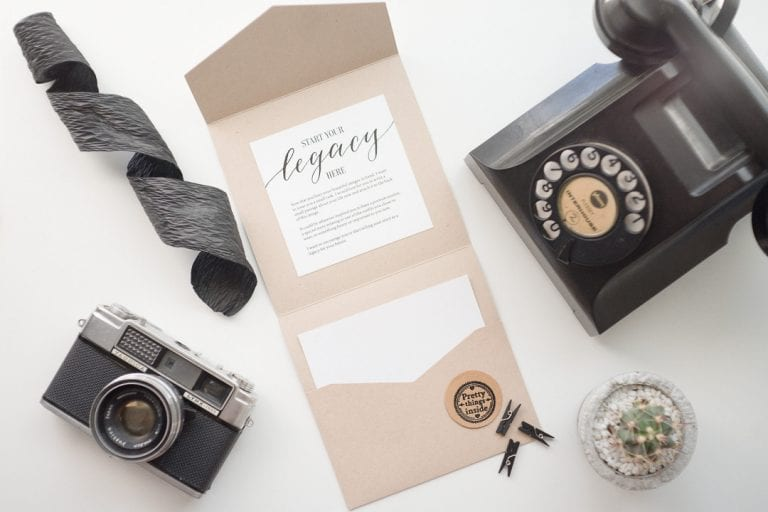 Flat lay of vintage telephone, camera and stationary design