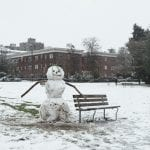 Snowman built at Kitsilano Beach on a snowy day in Vancouver BC