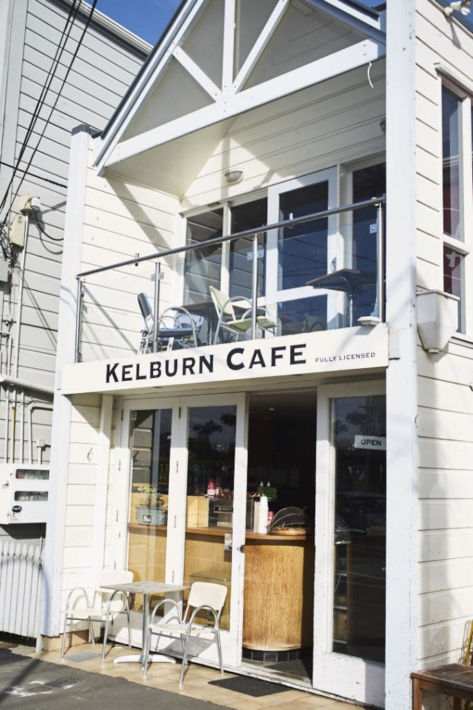 Image of Kelburn Cafe a wooden two storey building in the afternoon sun