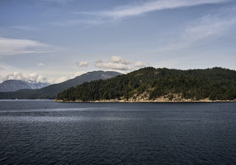 Image of the Sunshine Coast, BC taken from the ferry on a sunny day taken on the ferry heading back to Horseshoe Bay, BC