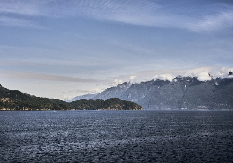 View of the Sea to Sky Highway with Mt Garabaldi in the background from the ferry from Langdale to Horseshoe Bay, BC