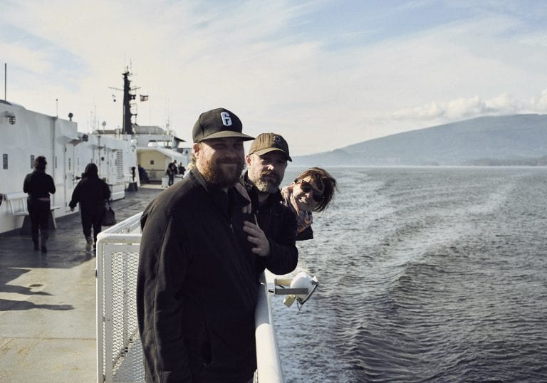 Image of 2 men and a woman posing and smiling for the camera on the deck of the ferry from Langdale to Horseshoe Bay, BC