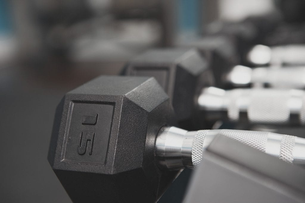 Image of hand weights in a personal trainers studio by Vancouver business portrait and branding photographer Angela McConnell