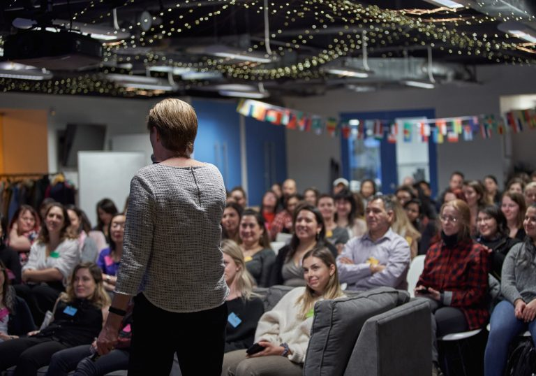 Attendees listen to a speaker during a women in male dominated industries WIMDI event hosted by Holly Burton who is helping women build careers they deserve by event photographer Angela McConnell