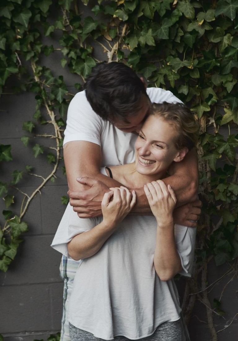 A couple embrace during a Wildfire Retreats date night in Vancouver by workshop and retreat photographer Angela McConnell