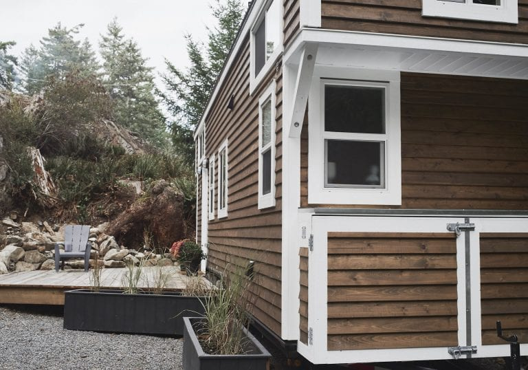 The exterior of a tiny home at Moulton Meadow Farm A free range chicken visits at the tiny house at Moulton Meadow Farm during a Thanksgiving getaway on Bowen Island