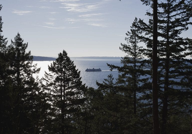 View from Dorman Point looking across to West Vancouver with a BC ferry sailing on the water during a Thanksgiving getaway on Bowen Island