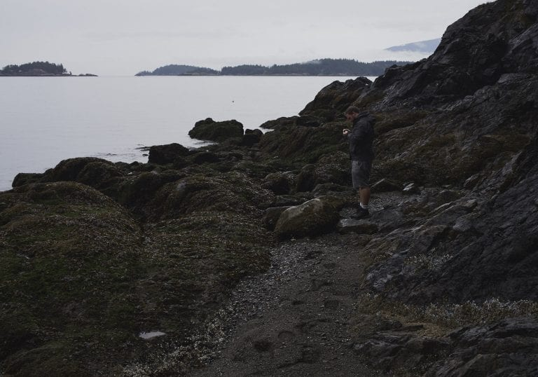 A man searches for rocks on the shoreline at Pebbly Beach during a Thanksgiving getaway on Bowen Island
