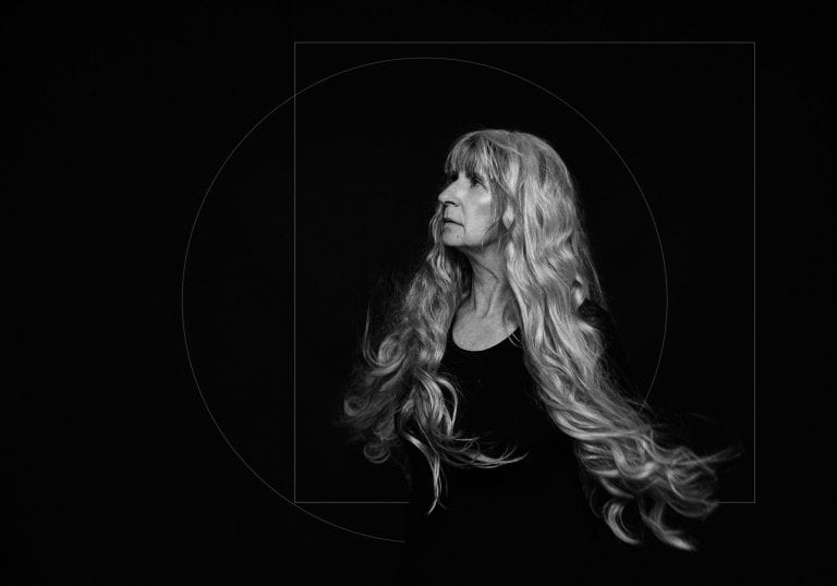 Black and white portrait of a mature model with long silver hair during contemporary portraits for women session by Vancouver contemporary portrait photographer Angela McConnell
