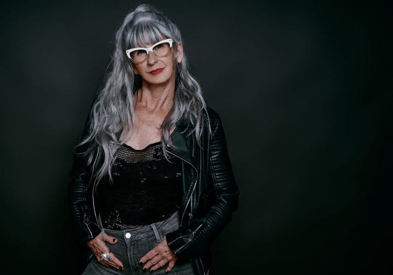 Contemporary portrait of a mature model with long silver hair by Vancouver contemporary portrait photographer Angela McConnell