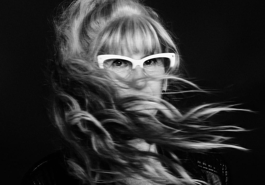 Black and white portrait of a mature model with long silver hair by Vancouver contemporary portrait photographer Angela McConnell