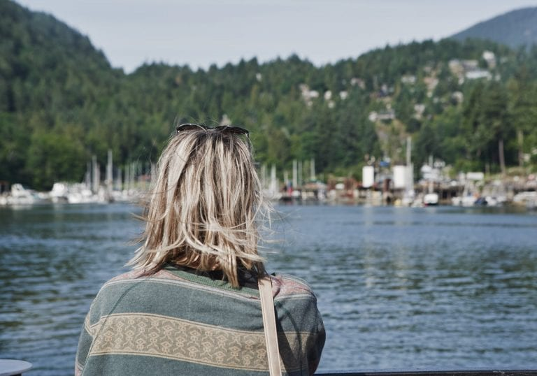 A women looks out from the ferry over to Bowen Island at a courage and bravery workshop by Vancouver workshop and retreat photographer Angela McConnell