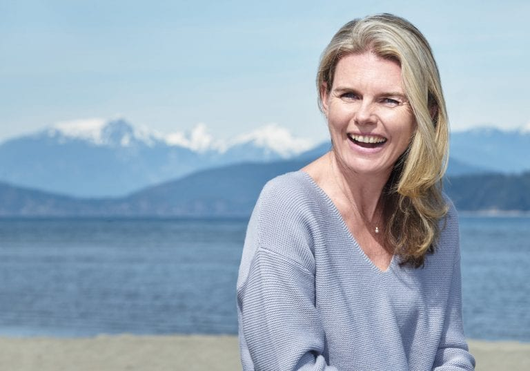 Natural light business portrait of a woman at Spanish Banks by Vancouver business portrait and branding photographer Angela McConnell