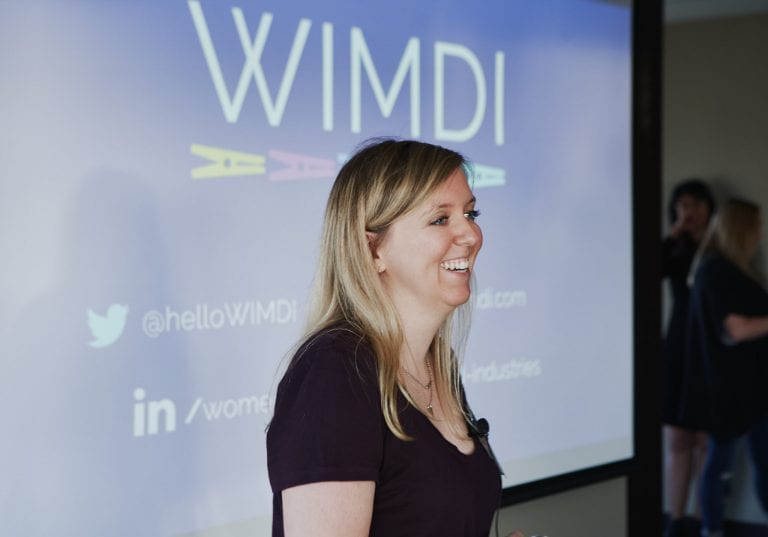 Holly Burton from WIMDI presents at the Women in Tech end of summer networking party by Vancouver photographer Angela McConnell