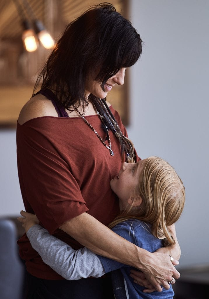 A mother and daughter hug during an exercise at a mother and daughter workshop by Vancouver workshop and retreat photographer Angela McConnell
