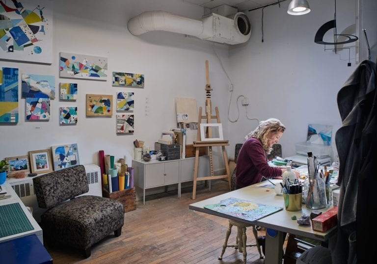 Environmental portraits with artist Ideet Sharon in her studio creating geometric collages by Vancouver photographer Angela McConnell